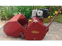 Petrol cylinder lawnmower. Self-propelled, with 18 inch cut. Professional quality. Hardly used.
