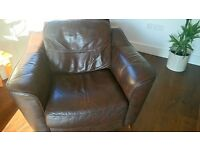 Brown leather sofa and chair.