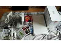 Nintendo wii with controller accessories and games