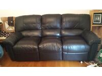Black leather recling sofa.