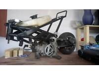 Bundle of racing mini motos and parts, good winter project