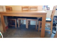 Oak effect dining table and six chairs