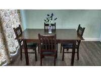 Walnut extendable dinning table and chairs