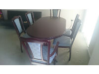 Solid extendable mahogany table, six chairs and matching cabinet.