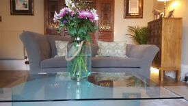 Designer Sofa and matching armchair. Excellent quality and condition. Dark grey.
