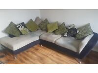 stylish corner sofa with scatter cushions