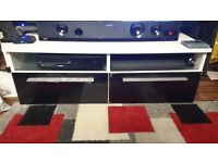 Black and white tv stand with blue led lights