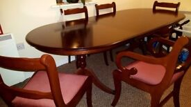Gorgeous wooden table with 6 chairs, including Queen and King