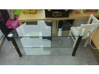 Tv stand glass and dark wood.