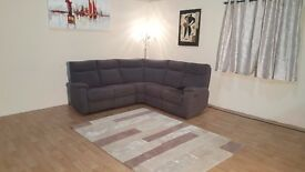 Jemima grey fabric electric recliner corner sofa