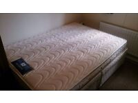 A clean double divan bed with 4 drawers and mattress