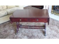 Mahogany coffee table with folding sides and two drawers
