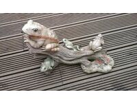 garden pond and water feature ornament. approx 18 inches long stone log with frogs sitting on.