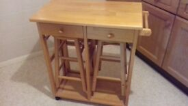 Kitchen table unit which extends and 2 stools on castor wheels with 2 drawers and towel holder.