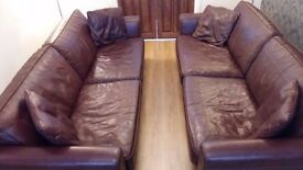 Two beautiful brown leather sofa's for sale.