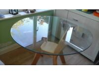 Circular Glass Dining Table Perfect for the Family Home