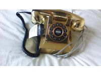 gold coloured telephone 60 style