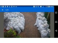 Free soil, in roughly 20kg poly bags, a few tonnes total