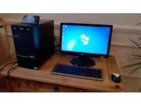 Asus K5130 desktop PC and monitor