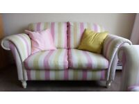 Pretty 3 piece suite in excellent condition. One 2 Seater Sofa and one arm chair