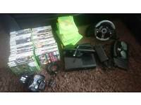 Xbox 360 slim 500gb e model, kinect sensor, 60x games, steering wheel