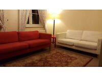 Two Ikea sofas Karlstad with covers