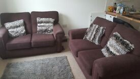 Two high quality brown two seater sofas