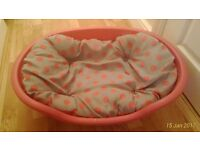 Pink pet bed with reversible cushion