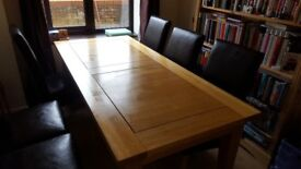 Large solid oak table. Good condition.