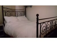 Lovely Ornate Black Metal framed double bed, inc mattress. Excellent condition.
