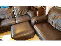 2 sofas and a foot stool