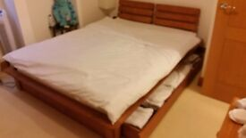 Kingsize bed with underneath storage, and mattress.