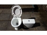 Low level toilet pan & cistern with toilet seat