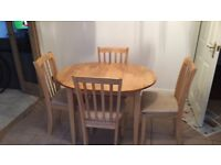 Lovely dining room table and 4 cushioned chairs. Excellent condition and collection only.