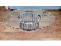 DFS glass oval coffee/occasional table with black/silver base in mint condition,