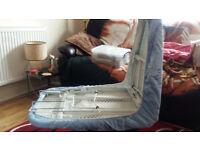 Table top folding ironing board