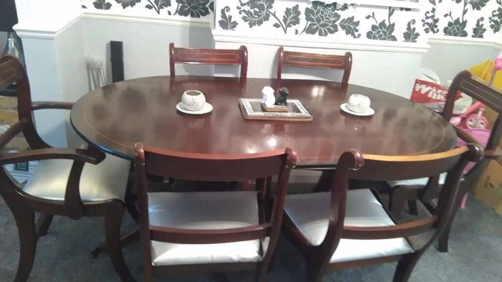 Dining set with 6 chairsin Farnborough, HampshireGumtree - Seats have been covered in silver leather, solid mahogany I was going to up cycle and paint grey/black but I need to re home it, sensible offers taken x