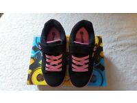 Size 1. Pink and black Heelys