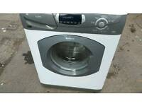 White and silver hotpoint washer dryer.