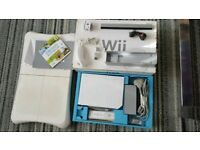 Boxed Nintendo Wii console with wii sports game + fitness board