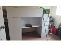 High sleeper with wardrobe, desk, storage area underneath and shelving to end