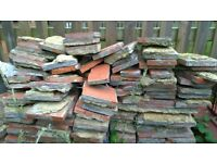 old quarry tiles with concrete on. Suitable for rubble or other diy project