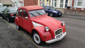 Lovable Red 2cv with 10 months MOT