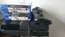 PS4 with 7 games & 2 controllers