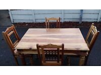 A Nice Solid Wood Table and Four Matching Chairs