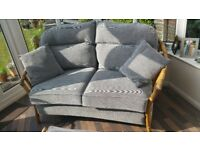 Cane 2 seater sofa by Angraves of Leicestershire from John Lewis