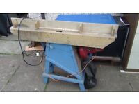 Industrial wood planer with custom table and dust extractor