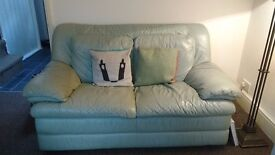 Two leather sofas, two seaters, pale green. Second hand furniture.