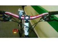 Mongoose vanish front suspension mountain bike with 21 gears