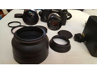 Nikon EM 35mm SLR Film camera with accessories